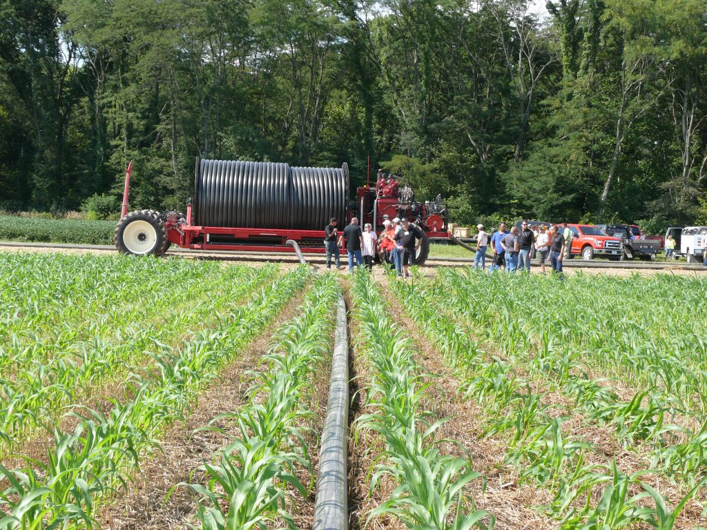 Figure 2: Cadman Continuous Manure Applicator (CMA) reel unrolling the hard hose as the tractor and injector move to the opposite end of the field.