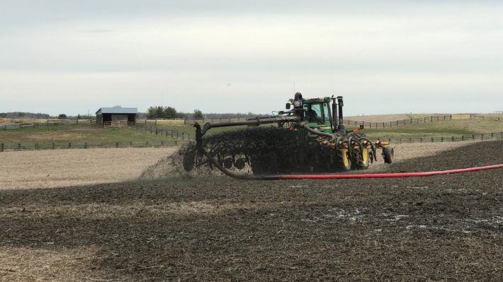 manure being applied prior to corn planting in 2020
