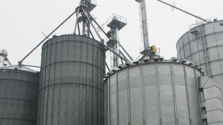 Image shows grain bins and a grain dryer on an Ontario farm